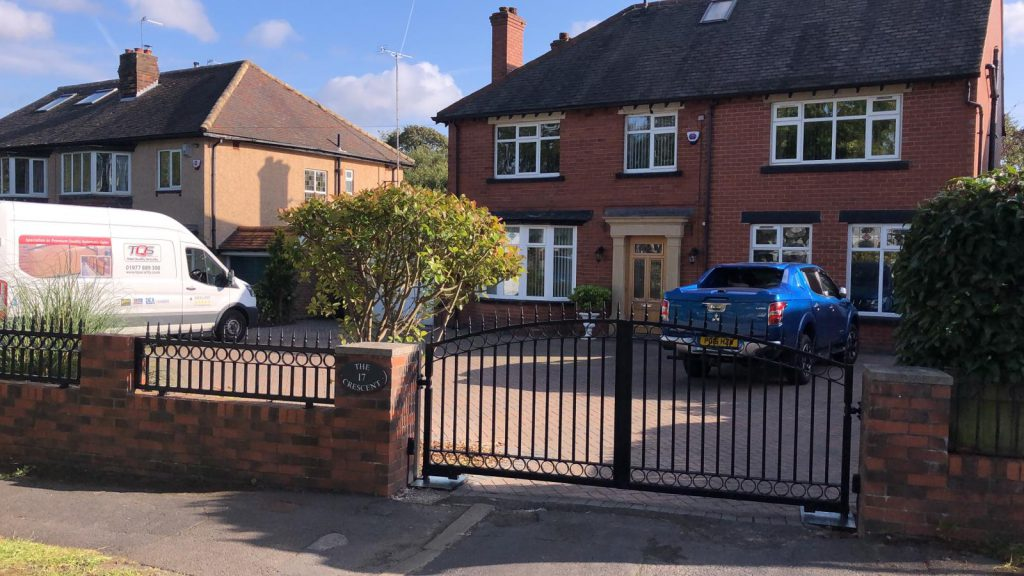 Wrought iron swing gates with railings